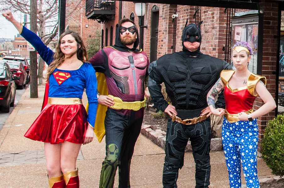 Supergirl (Kristin Wahl), Robin (Micah Usher), Batman (Chris Roberts) and Wonder Woman (Amber Cox) protect Soulard from evil-doers. - COURTESY OF MICAH USHER