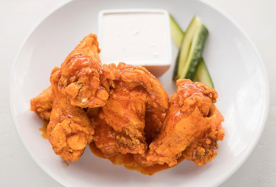Mango-habanero chicken wings are served with Danish bleu dip. - MABEL SUEN