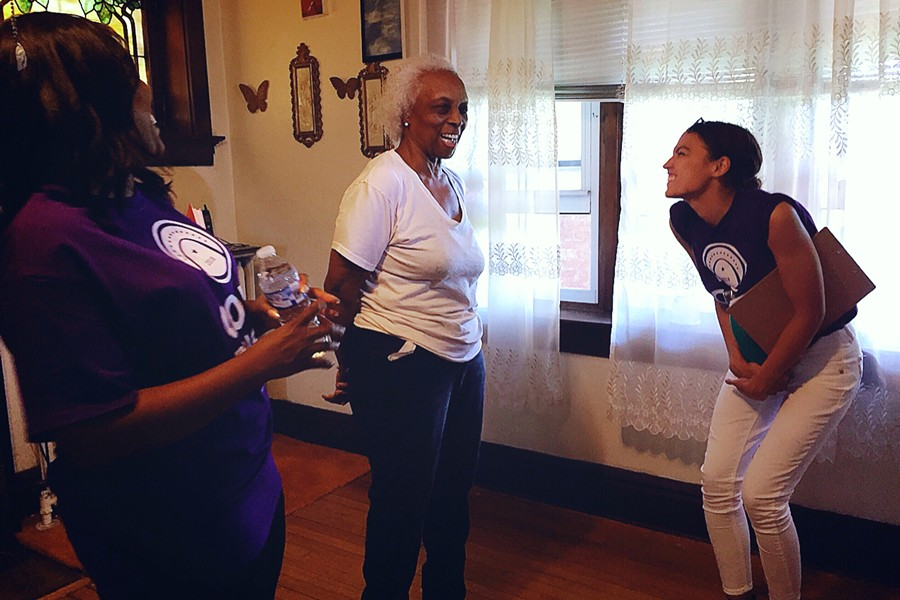 Elnora Daniels shares a laugh with the candidates. - PHOTO BY JAIME LEES