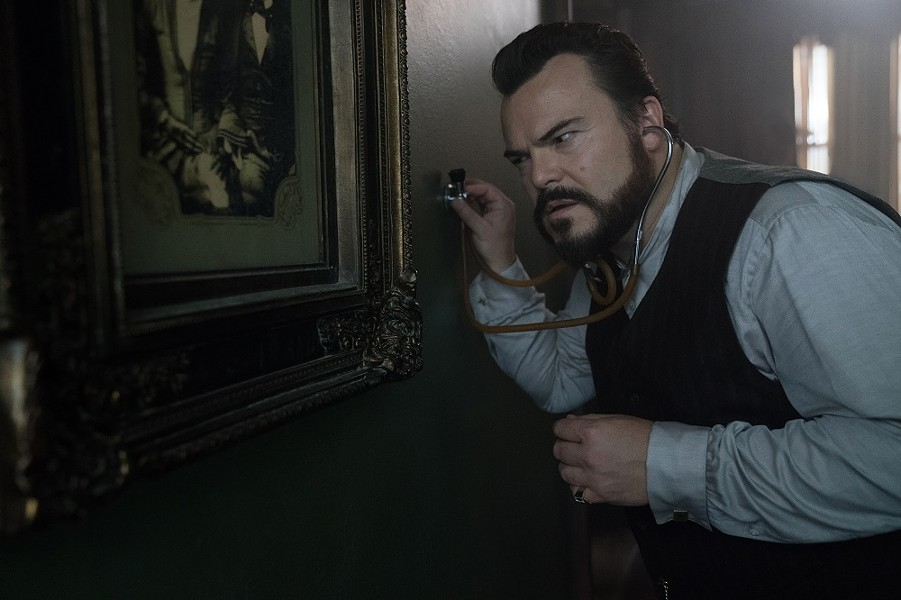 Uncle Jonathan (Jack Black) listens for the tell-tale sound of doomsday. - (C)  STORYTELLER DISTRIBUTION CO., LLC