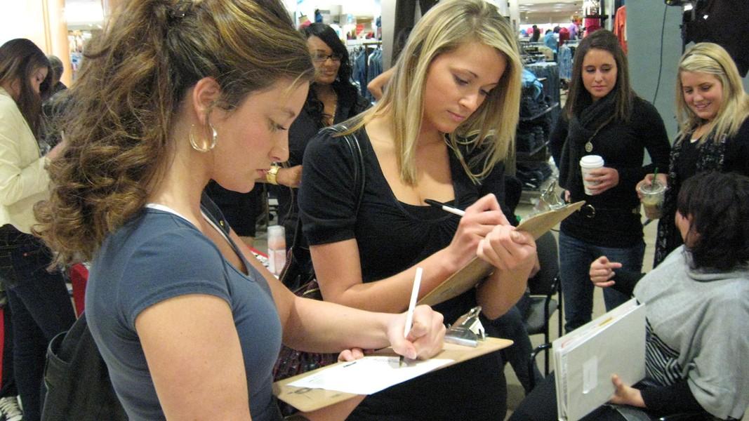 Stephanie Grimmer (left) and Eva Smoronski sign up for an audition slot.