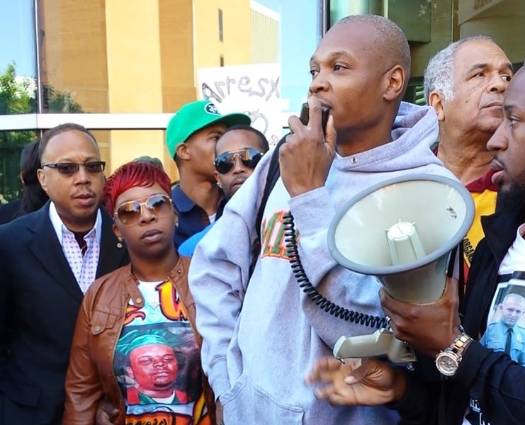 Eric Davis addresses a rally in Clayton in September with Michael Brown's mother, Lesley McSpadden. - JESSICA LUSSENHOP