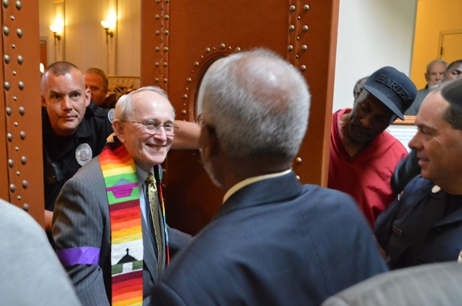 Reverend John Bennett, 74, is released from police custody after his arrest along with 22 other protesters. - MISSOURI FAITH VOICES