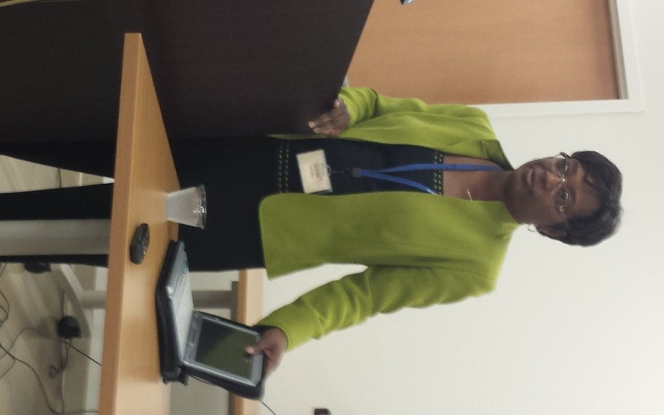 Director Dolores Gunn, of the St. Louis Health Department, with one of the laptops supplied by Gateway Technical Solutions.