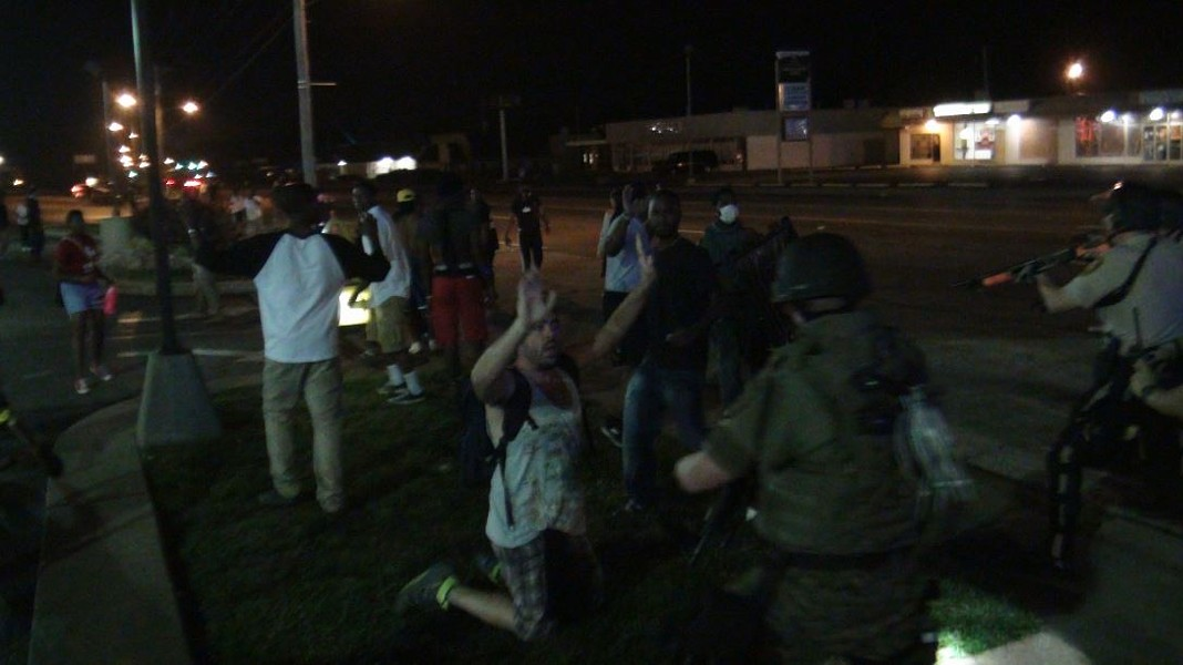 Police get ready to make an arrest Tuesday in Ferguson.