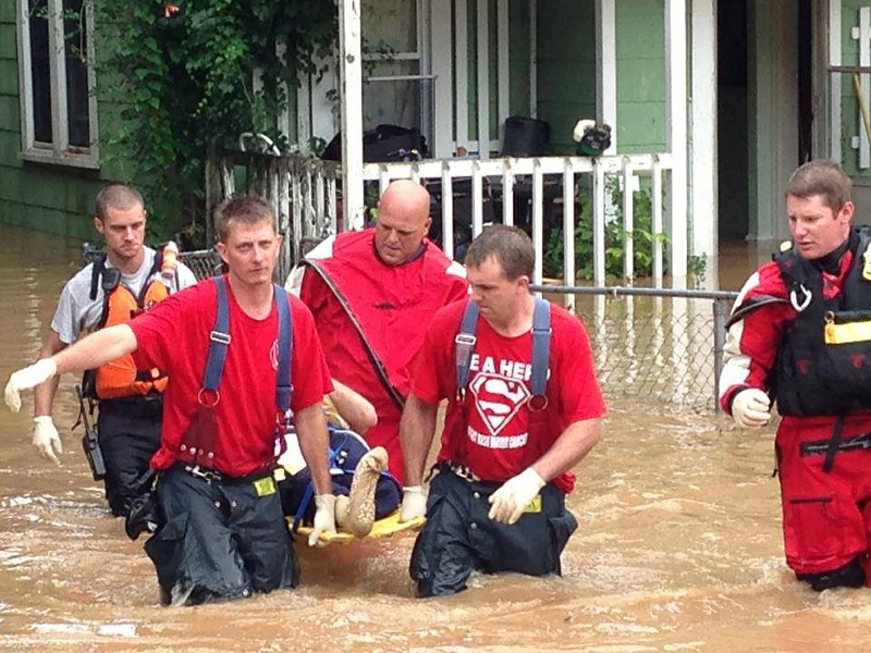 Waynesville MO...Firefighters (shown) from Waynesville, Bourbon, and various other fire departments are conducting water rescues in the Wayneville community. - VIA FACEBOOK / CITY OF ROLLA FIRE & RESCUE