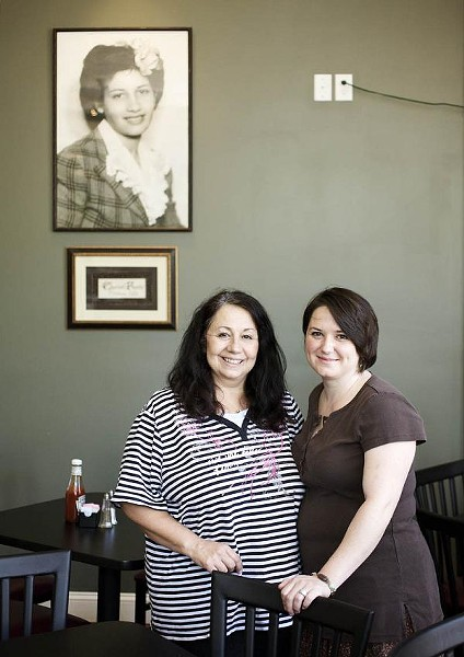 Owner Mary Samuelson (left) and daughter Amy Keller (right) posing below a portrait of Mary's mother and restaurant namesake, Josephine. - JENNIFER SILVERBERG