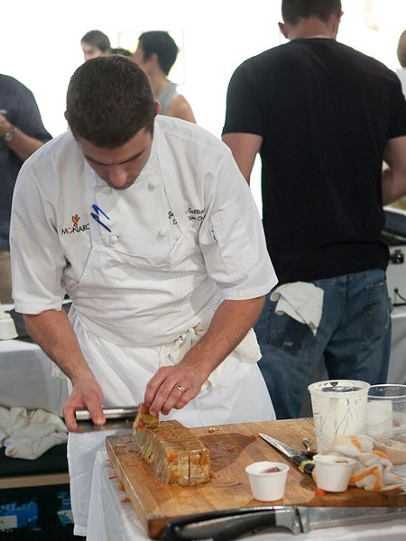 Josh Gallano of Monarch prepares some more of his dish. - PHOTO: STEW SMITH