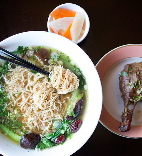 Mi vit tiem, the five-herb duck, is slow-cooked and served over egg noodles and baby bok choy. - JENNIFER SILVERBERG