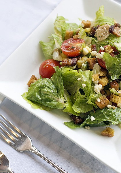 The second course is the Summer House Salad. This salad is made with fresh hearts of romaine, crispy bacon, marinated cherry tomatoes, buttery croutons, garden-fresh sweet corn, crumbled bleu cheese and balsamic vinaigrette. See more photos from Seasons St. Louis here. - PHOTO: JENNIFER SILVERBERG