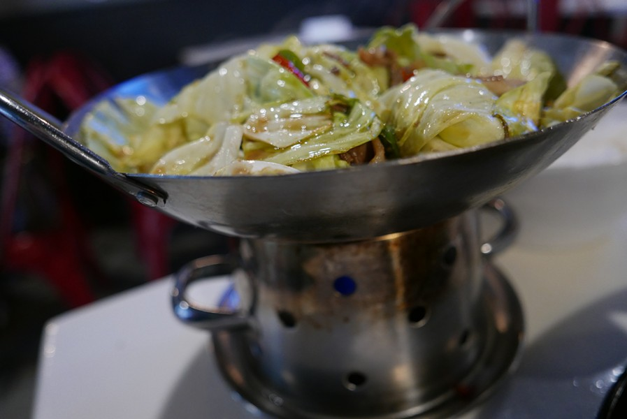 The grilled brussels sprouts comes on a hot stove, as do many other dishes on the menu. - DESI ISAACSON