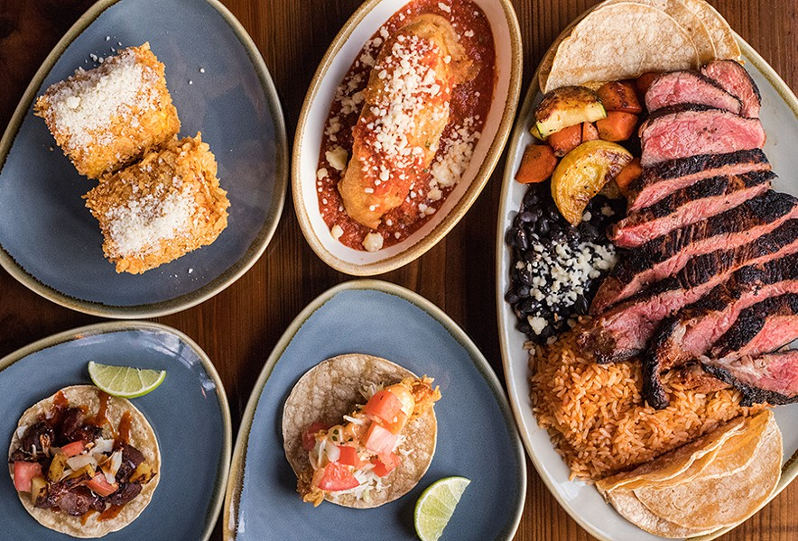 Barrio's menu features Latin American-inspired cuisine, including street corn, a chile relleno, a ribeye, a fish taco and a pork taco. - MABEL SUEN