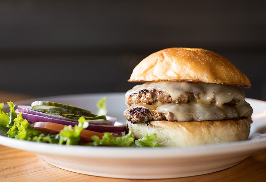 Frisco Barroom's double burger is topped with cheese, lettuce, tomato, onion, pickle and mustard relish. - MABEL SUEN
