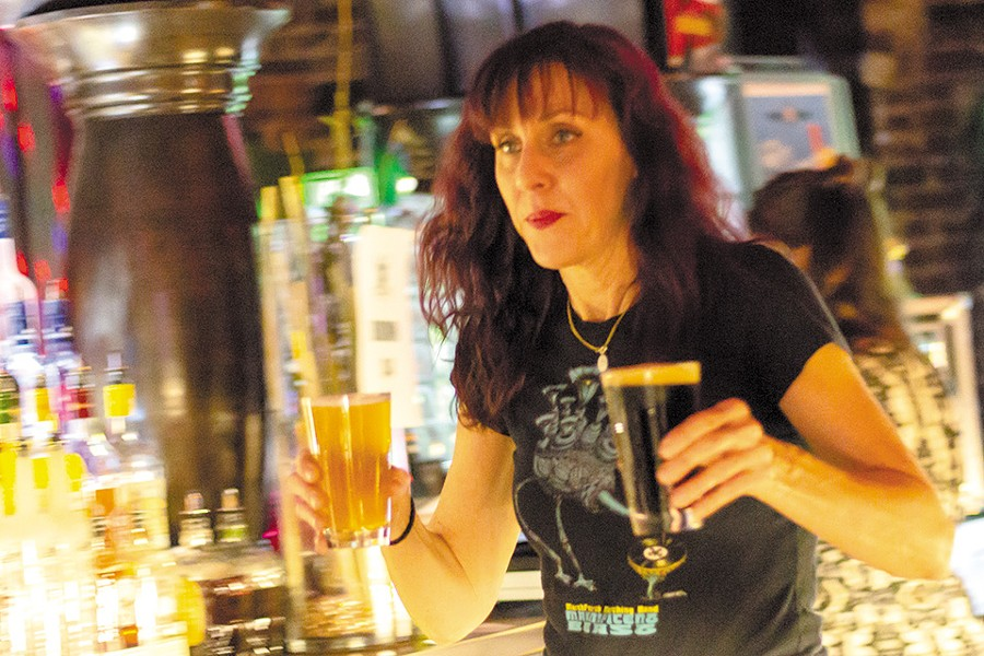Cindy Capps keeps the beer flowing at Old Rock House. - RYAN GINES