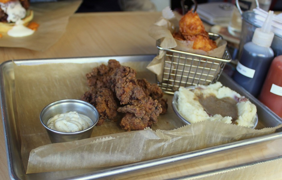 """Chicken """"nuggz,"""" tots and mashed potatoes with gravy. - PHOTO BY LAUREN MILFORD"""