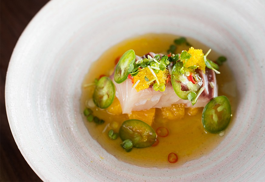 Hamachi crudo combines yellowtail with citrus and jalapeno. - MABEL SUEN