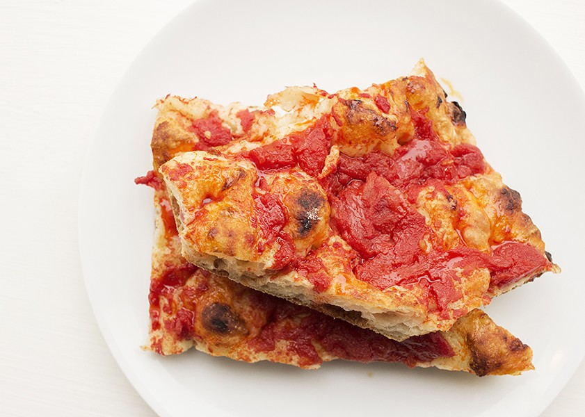 "Perfectly simple ""Pizza Rossa"" features tomatoes and chile oil. - MABEL SUEN"