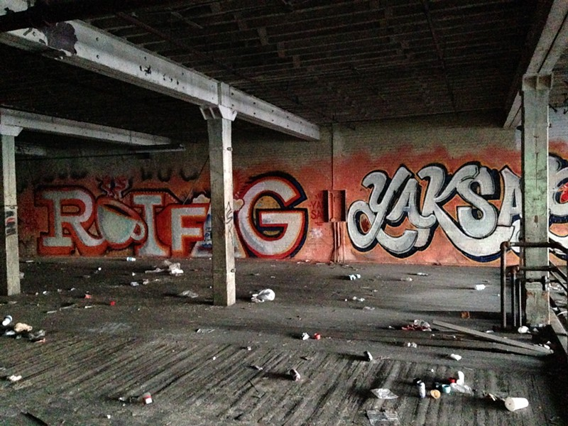 A mural covers an upstairs wall inside a vacant north St. Louis warehouse. - PHOTO BY DOYLE MURPHY