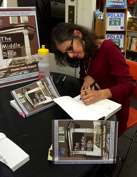 "Bogard signs her new book, ""The Middle Step,"" at Left Bank Books. ""I'm an author who created from her imagination and her experiences a cast of characters who lived in my head for almost a decade,"" she says. - CREDIT TO ROBERT BOGARD"