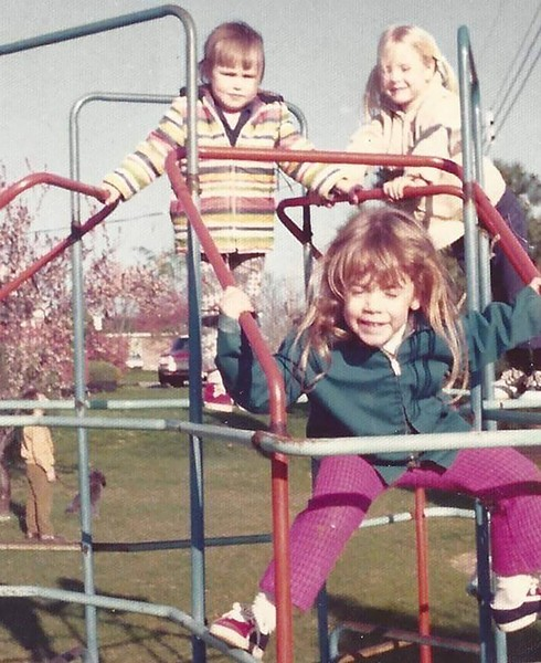 Kim Huffines (stripes) and Kim Thone Visitine (front) playing together as children in Florissant. - KERRY THONE VISITINE