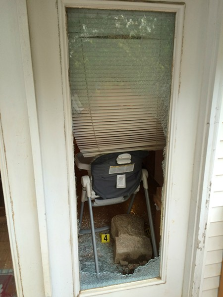 A concrete planter, used to smash the door glass, lies inside the Lakeshire home. - IMAGE VIA ST. LOUIS COUNTY POLICE
