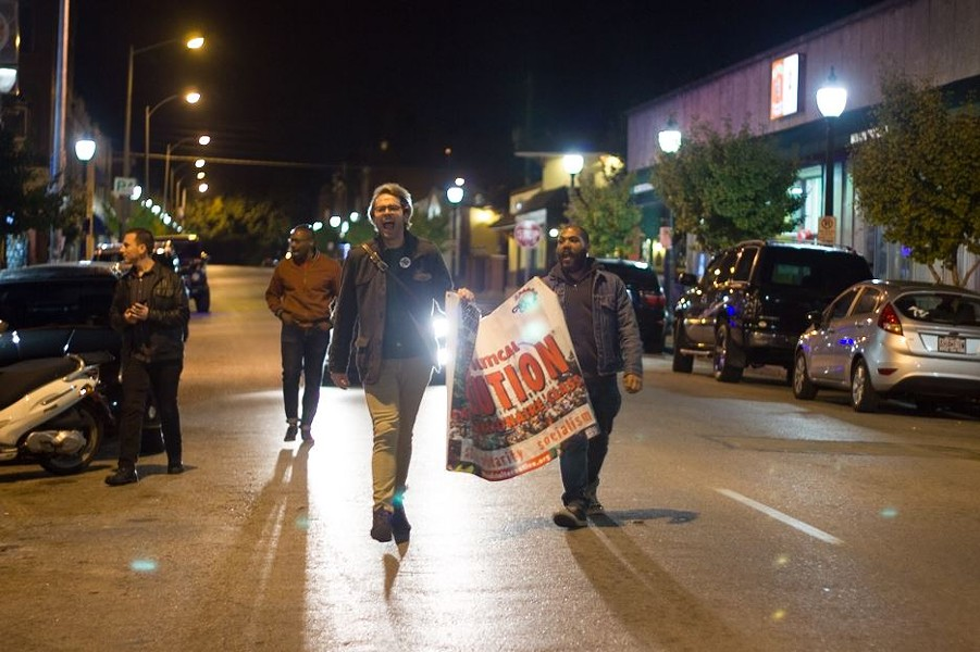 A small protest group marched down Cherokee Street after midnight. - PHOTO BY DANNY WICENTOWSKI