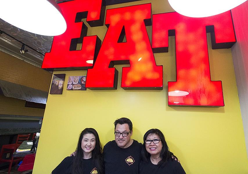 Olivia Shackelford, Mark Shackelford and Sue Wong-Shackelford. - PHOTO BY MABEL SUEN