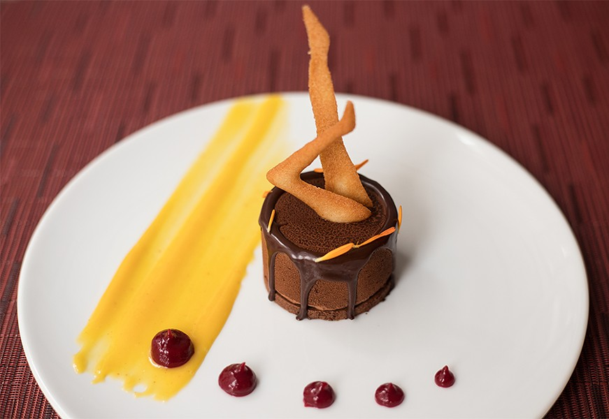 """Dark chocolate mousse is served """"Radio City Rockette style"""" in homage to the building's previous tenants. - MABEL SUEN"""