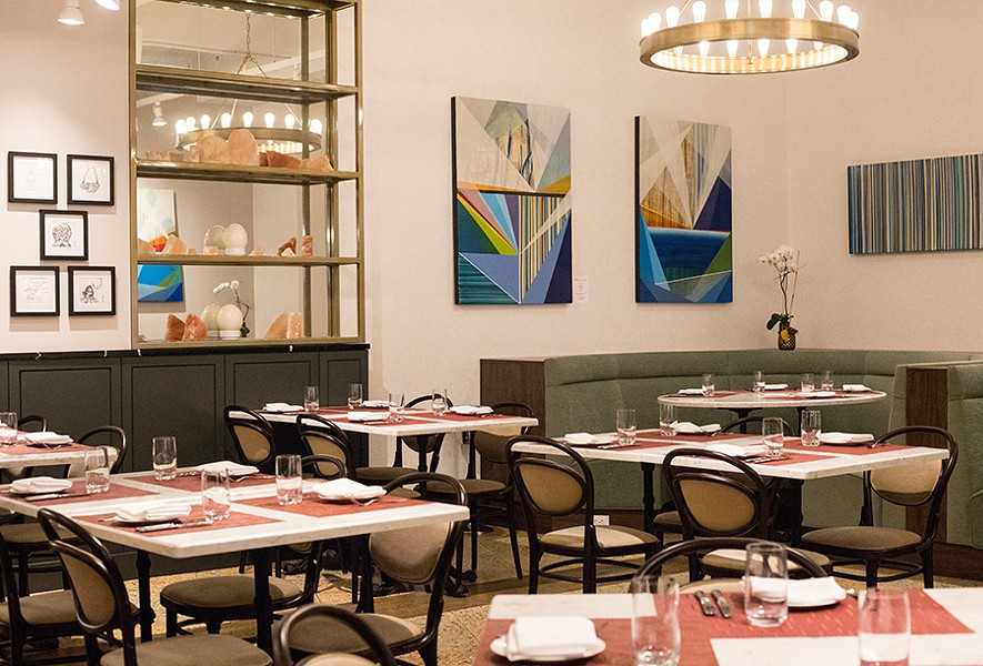 The dining room has a 1930s aesthetic befitting the space. - MABEL SUEN
