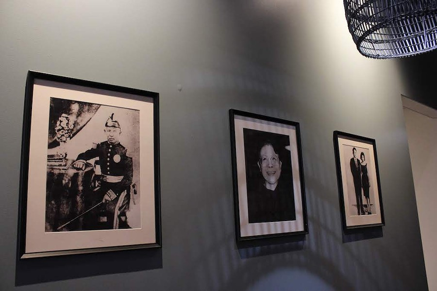 Pictures of some of Bognar's relatives line the walls. - KATIE COUNTS