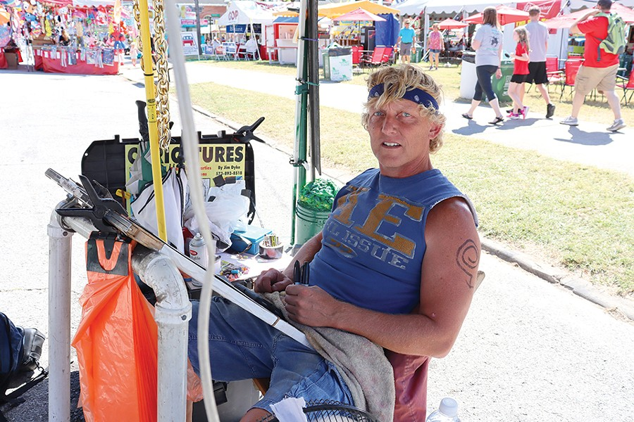 Jim Dyke takes a vacation from his day job every year to paint caricatures at the Missouri State Fair, where his running commentary is as entertaining as his artwork. - JAMES POLLARD