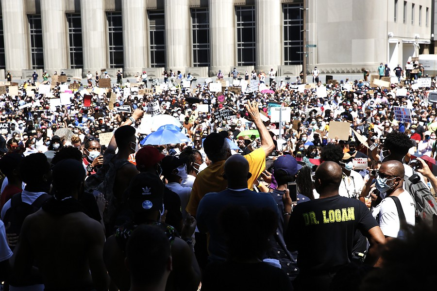 Protesters fill the street and sidewalks on June 7, 2020, outside the St. Louis Justice Center. - THEO WELLING