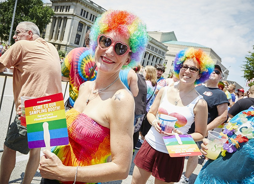Attendees enjoy Pride St. Louis' 2016 event. The parade will remain free, but in 2017, entry to the festival will be $5 per day. - PHOTO BY STEVE TRUESDELL