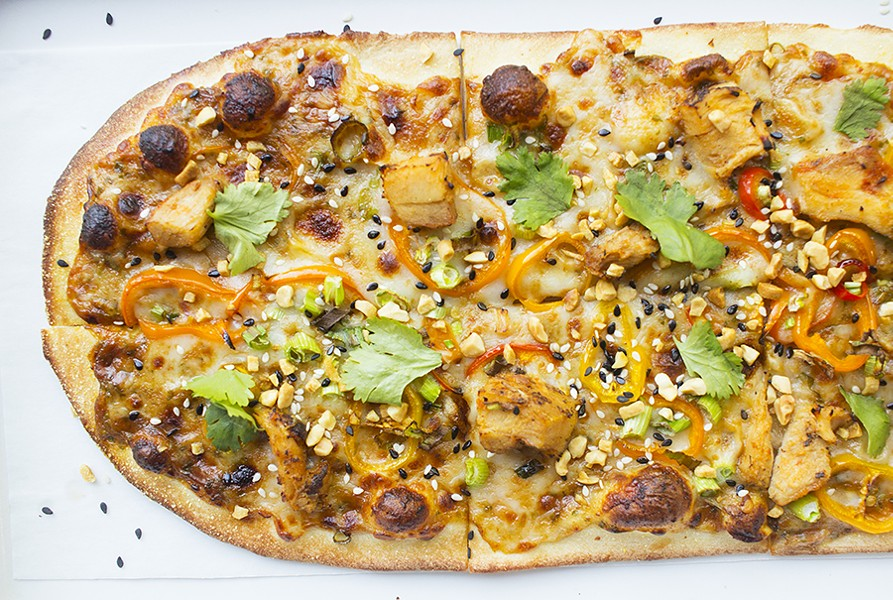"The ""Thai Dye"" features spicy peanut sauce, mozzarella, sweet pepper, chicken, peanuts, sesame mix, garlic and cilantro. - PHOTO BY MABEL SUEN"