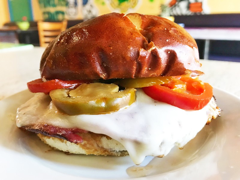SALAMI MELT WITH PROVOLONE CHEESE, CHERRY PEPPERS AND MUSTARD ON A PRETZEL BAGEL | SARA GRAHAM