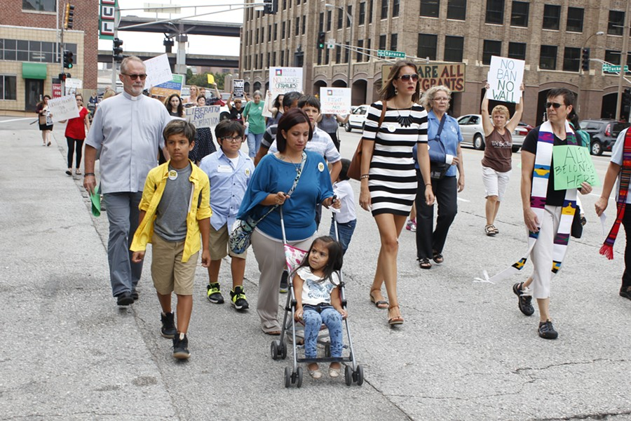 Carlene Garcia marches down Tucker Blvd. with supporters to the Thomas F. Eagleton Courthouse. - KATIE HAYES