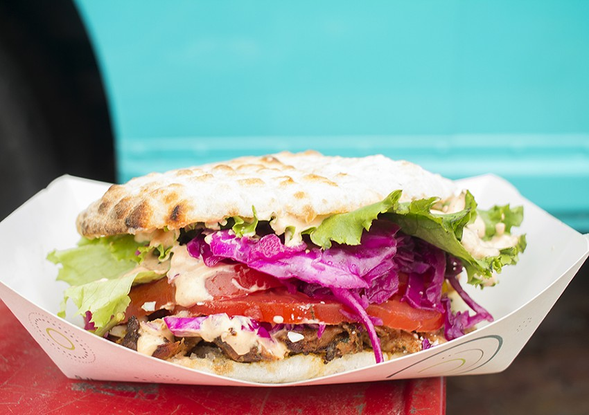 Döner comes with thinly sliced rotisserie chicken, served with somun,  a wood-fired bread similar to pita. - MABEL SUEN