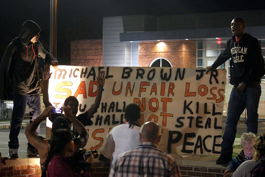 Protesters gathered outside the Ferguson Police Department on September 26, 2014. - PHOTO BY DANNY WICENTOWSKI