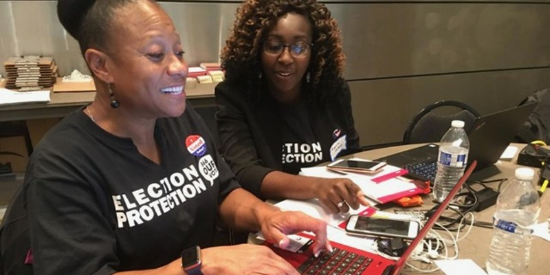 Two local attorneys from Mound City Bar Association working on voter issues on Election Day  during a past election at the St. Louis Command Center.