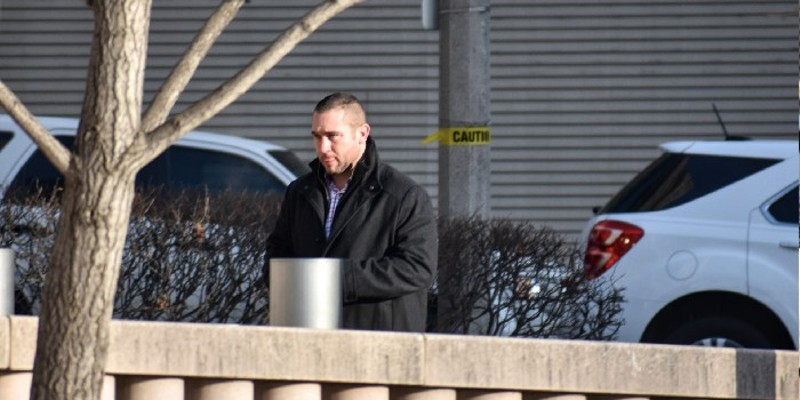 Ex-St. Louis cop Dustin Boone walks into federal court in 2018.