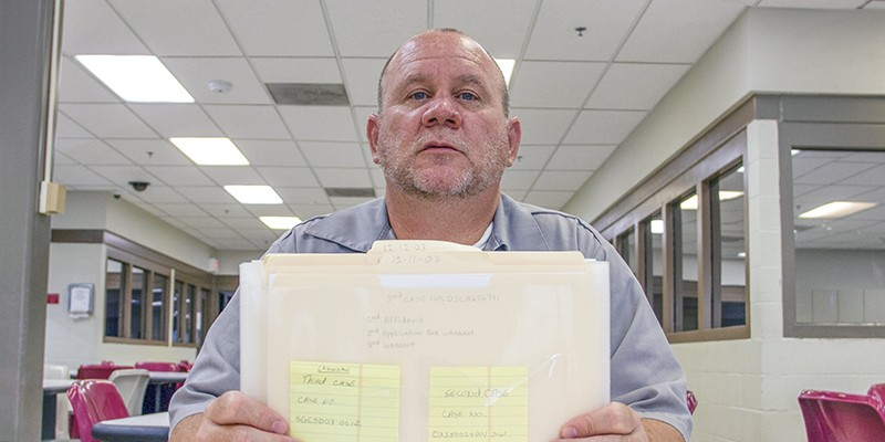 Timothy Prosser, shown here in 2016 with a collection of his legal files, is the only prisoner in Missouri serving a life sentence for drug charges.
