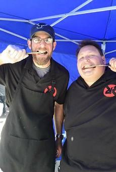Vernon's owner Matt Stiffelman and his teammate, Hunter Rose, celebrate at the Dallas Kosher BBQ Championships.