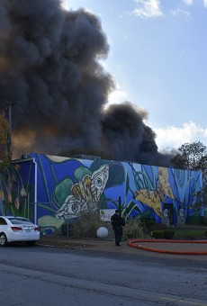 Smoke pours over the neighborhood from a warehouse fire in Botanical Heights.