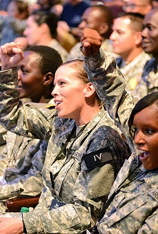 Soldiers cheer entertainment at a base in Texas. The U.S. Army has recently released a database cataloguing reports of assault.