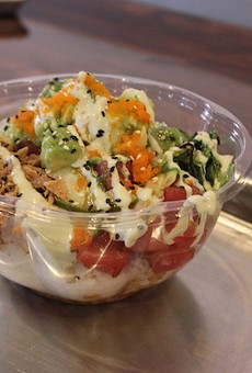 A medium-sized tuna bowl topped with avocado, fried onions, wasabi sauce and roe.