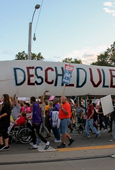 Legalization supporters carry a giant inflatable joint near the site of the 2016 presidential debate in St. Louis.