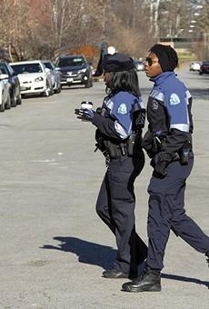 Devin Guajardo, right, and Jazmon Garrett serve as police anchors on Cherokee Street.