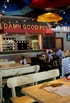 """The restaurant's motto hangs above the kitchen: """"damn good food,"""""""