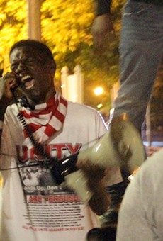 Josh Williams leads a protest chant on September 26, 2014.