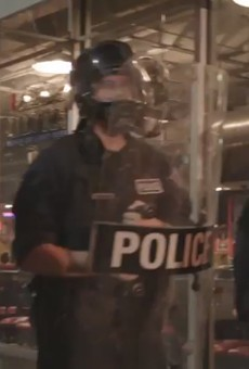 A video still from the kettle shows riot police walling off the intersection of Washington and Tucker.